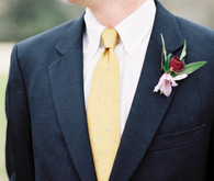 Groom boutonniere and yellow tie