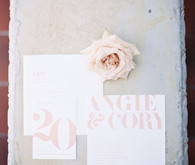 Light pink and white wedding invitation