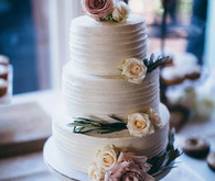 Elegant wedding cake with rose accent