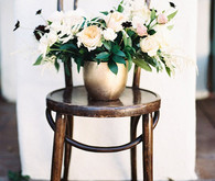 Gold vase centerpiece and white florals