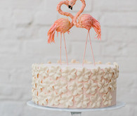 Pink cake with flamingo cake topper
