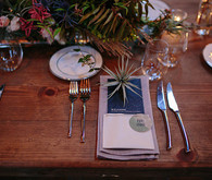Wooden tablescape with grey and blue place setting