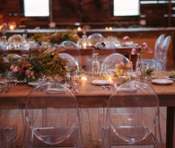 Wooden tablescape with clear chairs