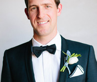 Groom with bow tie and boutonniere