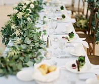 White tablescape with eucalyptus decor
