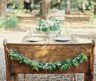 Wooden tablescape with garland