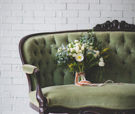 Green vintage couch with bouquet