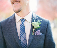 Blue and white suit with green boutonnière