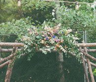 Backyard Utah Wedding Atlar with Florals
