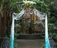 Aqua and gold wedding altar