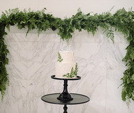 Modern Green and White Same Sex Wedding Cake