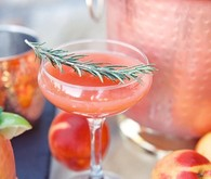 Orange cocktail with sprig