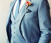 Blue Suit with Orange Boutonniere