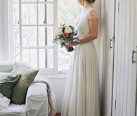 Lace cap sleeved wedding dress