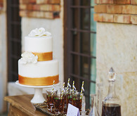Gold and white wedding cake