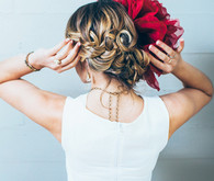 Bridal hairstyle with red flower headpiece