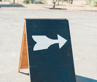 Wooden black and white arrow sign