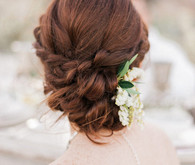 Bride hairstyle with small flower