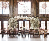 Rustic indoor wedding with floral arch