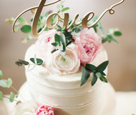 White floral cake with love cake topper