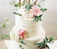 White floral cake with love signage