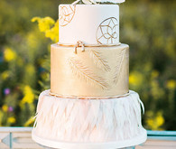 Gold and white cake with feathers