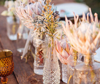 Clear vases with pastel protea