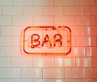 Red glowing bar sign