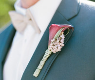 Plum boutonniere with dark blue suit