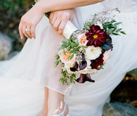 Plum bouquet and white shoes