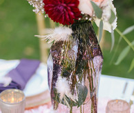 Colorful plum flowers with feather accents