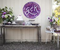 Purple and silver dessert table with custom sign