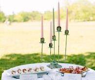 Wedding food table with high candles