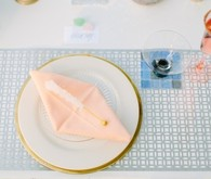 Peach and light blue place setting