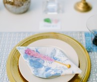 Iridescent gold and light blue place setting with rock candy