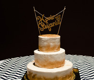 Gold, black and navy wedding cake topper