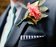 Pink boutonniere with navy suit