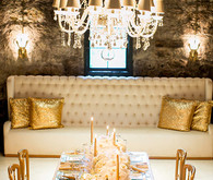 New Years gold tablescape with chandelier
