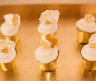 Mini gold and white cupcakes