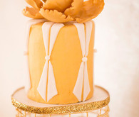 Gold cake with floral topper