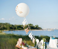 Nautical tables cape with giant balloon and tassels