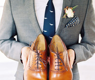 Classic men's shoes and grey suit