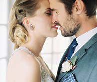 Classic wedding kissing portrait
