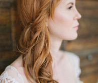 Relaxed side swoop bridal hairstyle