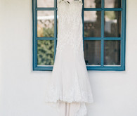 White lace Watters wedding dress