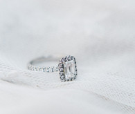 Emerald cut diamond with halo and platinum band