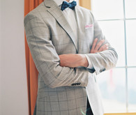Groom with grey suit and blue bow tie