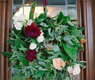 Greenery and deep red hanging flowers