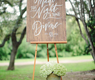 Wooden signage with white calligraphy