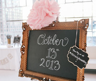 Gold chalkboard sign with giant pink flower